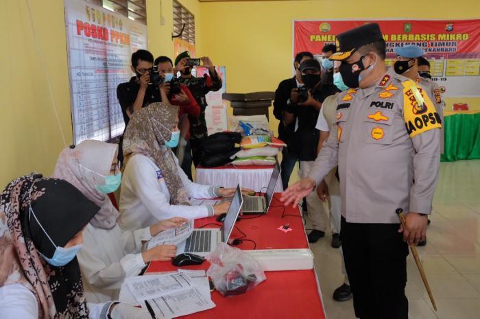 Berikan Bansos dan Gelar Vaksinasi, Kapolda Riau : Kolaborasi dan Sinergi Mampu Tangani Covid-19